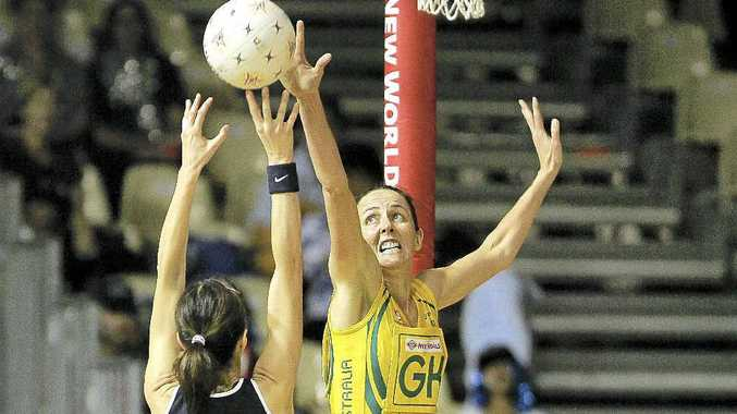 Australian captain Liz Ellis defends against Scotland's Sharyn Lyon during a Netball World Championships game in Auckland, New Zealand, in 2007.