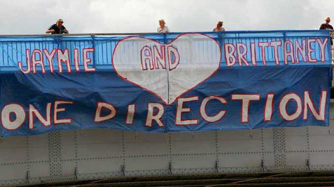 The Rockhampton 'shrine' banner in place on the Fitzroy Bridge letting everyone know that Jaymie and Brittaney love One Direction.