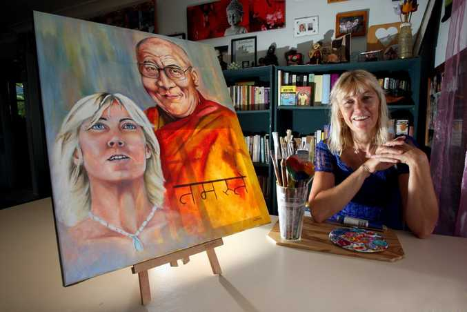 Artist Cath Grant with painting of the Dalai liama.
