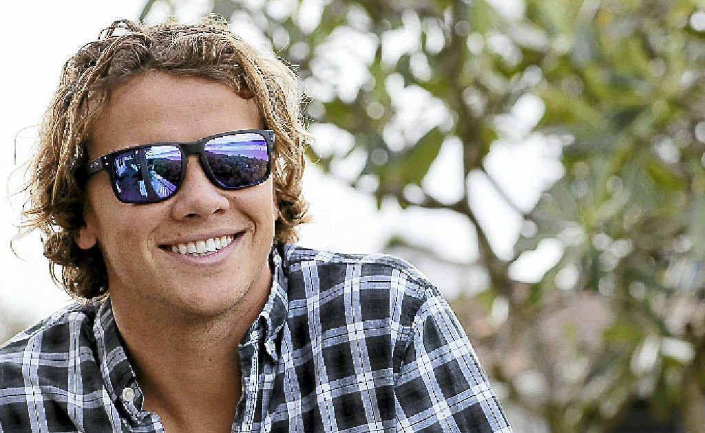 Julian Wilson wears his new sunglasses. He also has released a range of board shorts.