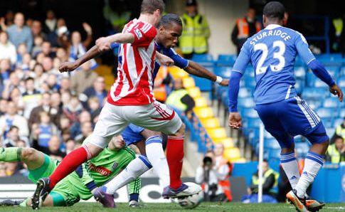 Didier Drogba got the decisive goal as Chelsea beat 10-man Stoke at Stamford Bridge.