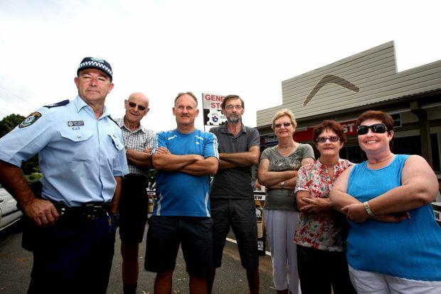 Sergeant Stuart Crawford, with neighbourhood watch residents Rex Smart, Peter Graham, John Pitt, Betty Smart, Lyn Pickett and Cassandra Picket. The group will hold a public meeting this week.