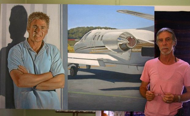 Part-time weed management officer Raymond Cheney with his portrait of Mick Doohan.