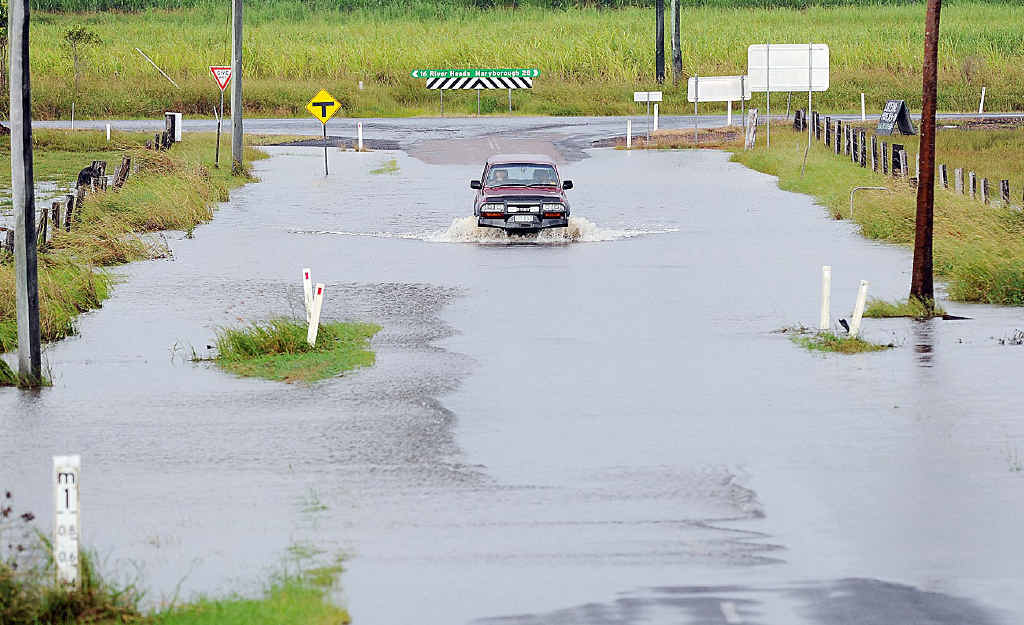 The end of Woods Rd at Booral Rd at Nikenbah, one local intersection which regularly goes under water with heavy rain.