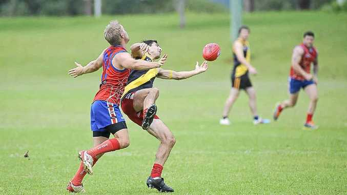 Lismore's George Massa stretches to take a mark during the pre-season final against Redbacks at Hepburn Park.