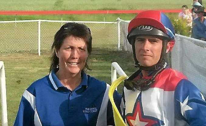 Trainer Glenda Bell and apprentice jockey Shane Egan are all smiles after winning the Springsure St Patrick's Day Diamond Jubilee Cup with Down Another Track.