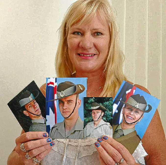 Alison Bonner with photos of her children (L-R) Sgt Shane McPhee, Saper Darren McPhee, Private Nick McPhee and Private Lauren McPhee.