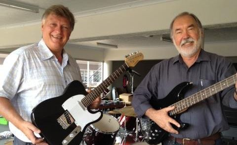 Owen Ray and former band mate Barry Bernoth get ready for this Saturday's International Music closing down auction.