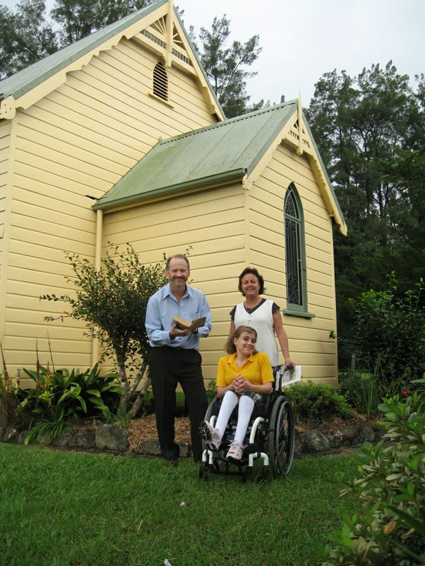 Brian Purcell with Anne Cichra and Gabbie beside the Gleniffer Church, where a fund-raising marathon reading of Oscar and Lucinda will take place this Sunday.