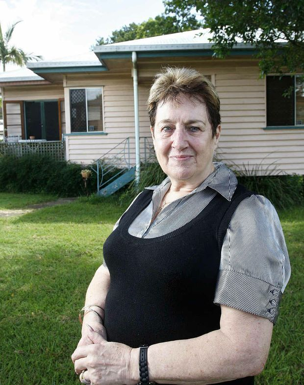STAYING PUT: North Booval resident Sheila Smith outside her home which didn't flood in January 2011. Sheila isn't worried about the price drop in houses in the area. Photo: Sarah Harvey