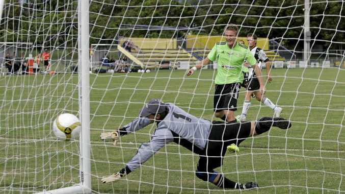 Centrals keeper David Langden dives to his left but is well beaten by a header from Eagles' James Barley during the Stanwell Cup game at Jardine Park.