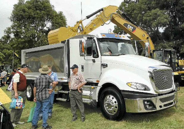 HEAVY DUTY: CAT's truck was surrounded by CAT earthmoving equipment.