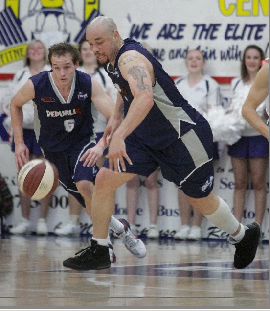 Rockets' Travis Reed surges up the court at Hegvold Stadium during a QBL match last season.