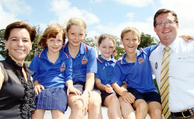 LNP candidate for Nanango Deb Frecklington (left) and LNP candidate for Toowoomba North Trevor Watts (right) with future students of the Highfields high school (from left) Anna Cairns, Kaitlyn Cairns, Amy Wells and Linden Wells at this morning's announcement.