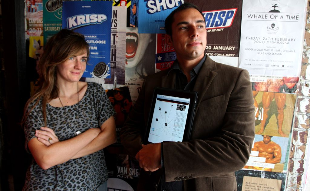 Louisa Miranda and Ben Farr-Wharton with the new web site on an iPad.