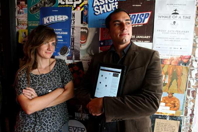 Louisa Miranda and Ben Farr-Wharton with the new web site on an iPad.