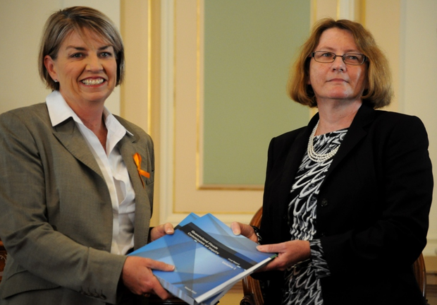Anna Bligh receiving the Floods Commission of Inquiry report.