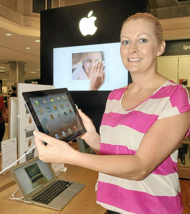 Kristy Gray checks out the new iPad at Myer, Sunshine Plaza.