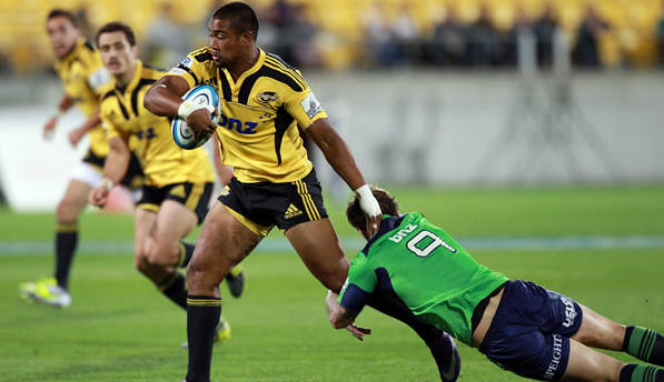 Julian Savea tries to break free for the Hurricanes