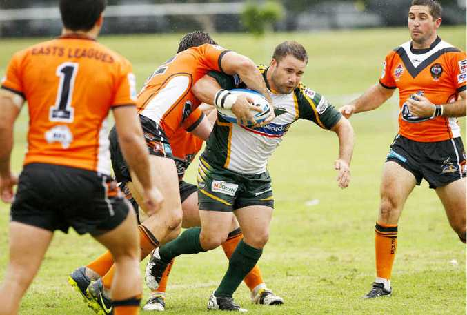 Ipswich Jets captain Ian Lacey tries to shake the Easts defence during Saturday's cruel 15-14 loss at North Ipswich Reserve.