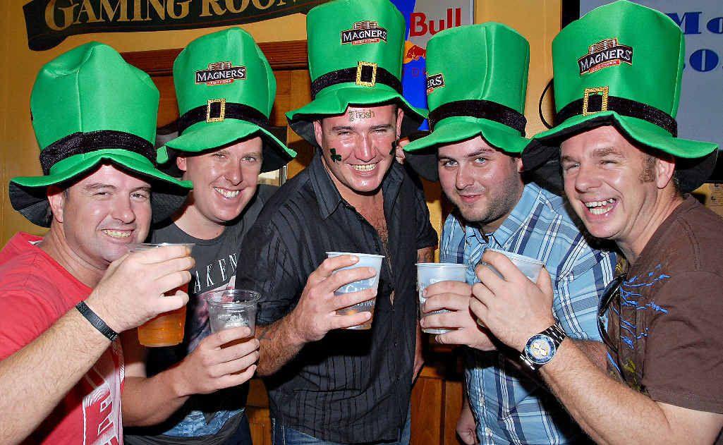 Jason Hageley, from Yugoslavia (left), Brendan Healy (County Kerry), Shane Foran (Offaly), Liam Connolly (Dublin) and Gavin Reddick (UK) celebrate St Patrick's Day at Kate O'Reilly's Irish Bar on Saturday.