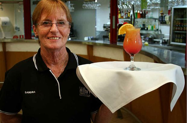 Former primary school teacher Sandra Morris serves up a drink at Rockhampton's Brunswick Hotel after starting a CQ TAFE course in hospitality earlier this year.
