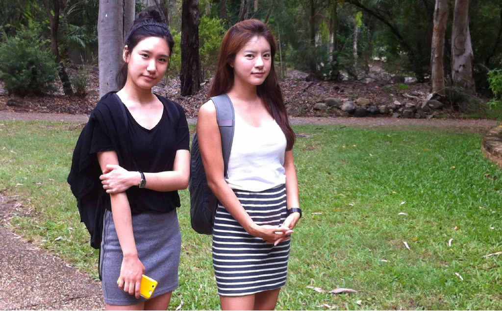 Korean students Youngju Choi and Seokyung Cho walk through CQUniversity's Rockhampton campus. The pair say even though it's not cheap they have chosen to study in Central Queensland.