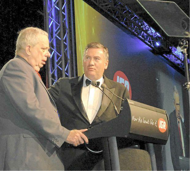 Derek Cornett receives his Retailer of the Year award from Eddie McGuire in 2010. Mr Cornett has been in the retail business for 68 years.