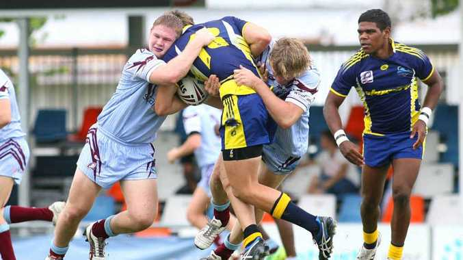 Young Capras Hayden Collins and Fletcher Jarrett stop a raid by the Townsville Stingers at Browne Park on Saturday.