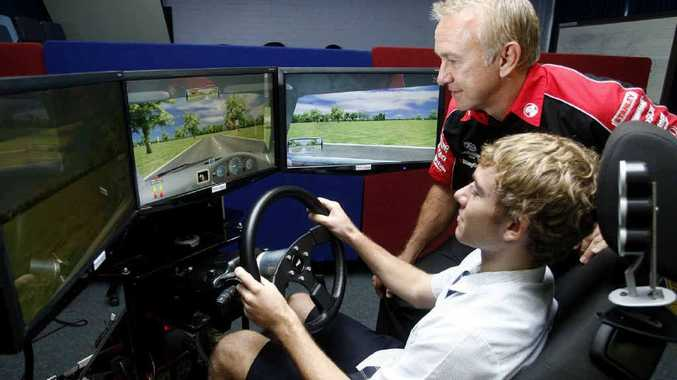 V8 Supercar driver Russell Ingall gives a few tips to Ipswich High student Michael Todd.