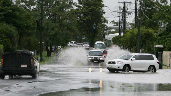 Traffic on Deans St had to deal with water over the road after heavy rain, most of which fell between 9am and 3pm.
