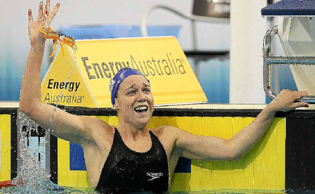 Tessa Wallace looks to her supporters in the crowd after winning last night's 200m breaststroke final. Inset: Melanie Schlanger punches the air with delight after taking out the 100m freestyle final at the Olympic trials in Adelaide.