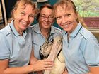 BRAVE BIRD: The Twinnies and their sister Mishele Blizzard with Charlie the pelican.