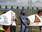 Protesters Peter Kuestler (left) and Ronald Brouwer join the blockade outside Saxon Energy's Toowoomba site yesterday.