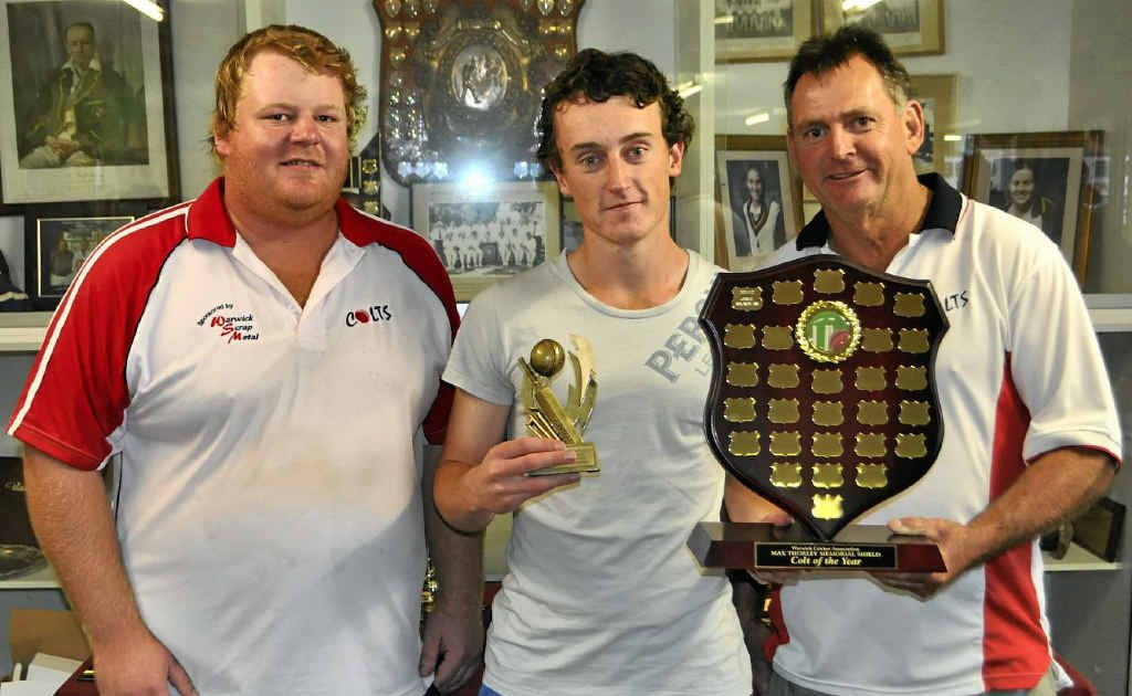 Jamie Saunders (centre) won the Max Thorley Memorial Colt of the Year award and was named player of the year in Warwick cricket. He is with Max's brother Geoff and father Joe.