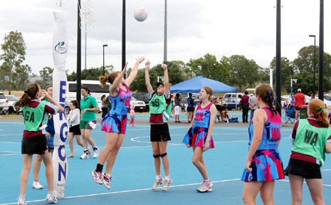 NEW COURTS: Phoebe Van Itallie attemps to block a shot during the Gay Fraser Cup Competition played in the rain in Biloela on Sunday.