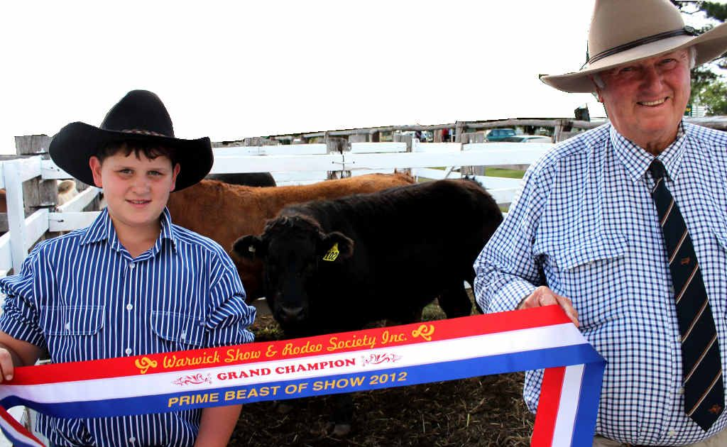 CHAMPION: Bill Gross with grandson Ben with their winning steer which won the 2012 Warwick Show prime cattle competition.