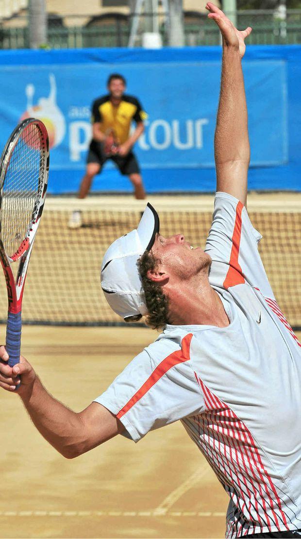 James Lemke serves to Erik Chvojka in the men's singles final of the Bundaberg Tennis International ITF Pro Circuit at Drinan Park.