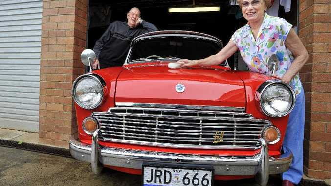 John and Nella Devoy of Goonellabah with their 1963 Datsun Bluebird. They have lovingly restored the car and still drive it every day.