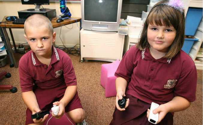 Stanwell State School students Branden Newton and Hope Geiger are disappointed after a thief pinched one of the school's two Wii systems.