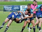Tweed Heads' Tom Merritt is heavily tackled by Sea Eagles Kane Richards and Mitchell Buckett at Stockland Park.