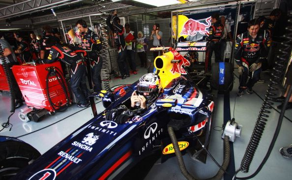Sebastian Vettel of Germany and Red Bull Racing tries to keep cool as he prepares to drive during qualifying for the Malaysian Formula One Grand Prix