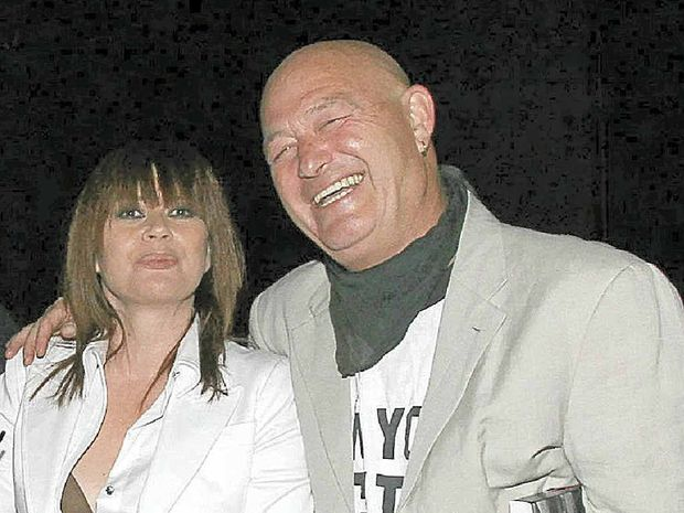 Music industry legend Vince Lovegrove, pictured in a file photo with lead singer of The Divinyls Christina Amphlett.
