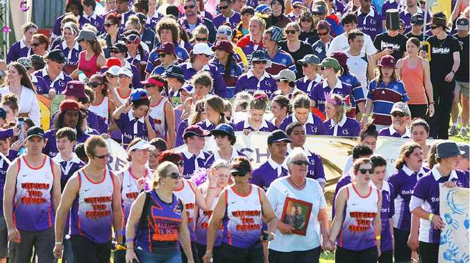 A massed crowd of participants start their long journey in the Relay for Life event at Jim Finimore Oval.