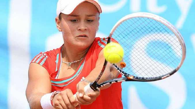 Ipswich player Ashleigh Barty focuses hard during yesterday's City of Ipswich International Tennis final against winner Sandra Zaniewska at Leichhardt.