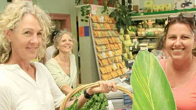 Santos Health Foods Mullumbimby's Sandra Buck (left) and Sandra Hotz (far register) serve customers on a busy Monday afternoon.