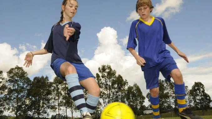 Casino Christian School soccer players Amanda Huxley and Dylan Ryan, both in Year 6, prepare for the Bill Turner knockout competitions.