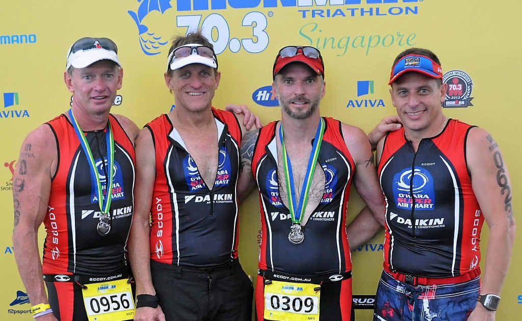 Mackay men (from left) Matt Perkins, Russell O'Hara, Neil Rissman and Brendan Camilleri after competing in the Singapore 70.3 triathlon.