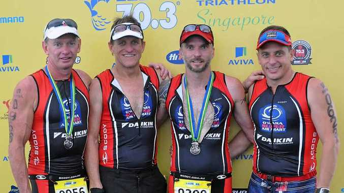Mackay men (from left) Matt Perkins, Russell O'Hara, Neil Rissman and Brendan Camilleri after competing in the Singapore 70.3 triathlon.