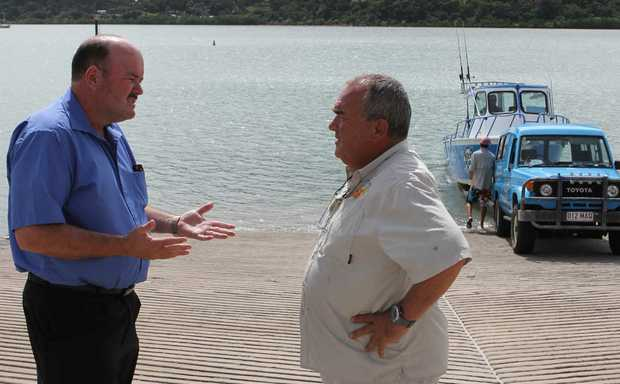 DISCUSSION: Mayor Mike Brunker talking with local fisherman Bob Spees as the first boat is launched at Port of Airlie on Tuesday.